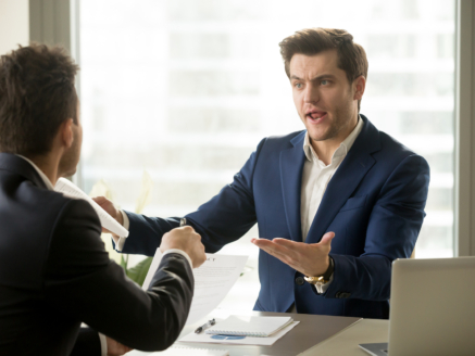 Businessmen arguing at workplace, disagreeing over document, partners having conflict while negotiating, business deal failure, agreement cancelation, breaking contract, unacceptable terms