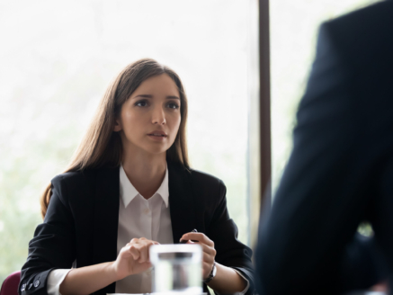 Focused millenial businesswoman or executive participating in important negotiations